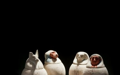 A Set of Four Egyptian Painted Limestone Canopic Jars