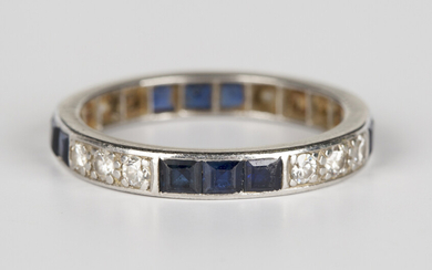A diamond and sapphire full eternity ring, mounted with four rows of three circular cut diamonds alt