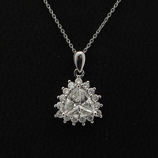 A diamond pendant set with three fancy-cut diamonds encircled by numerous brilliant-cut diamonds, mounted in 18k white gold. Accompanied by necklace.