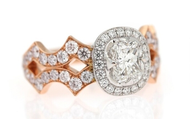 NOT SOLD. A diamond ring set with a diamond weighing 1.00 ct. encircled by diamonds...
