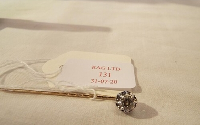 A diamond set stick pin approx size 4ct