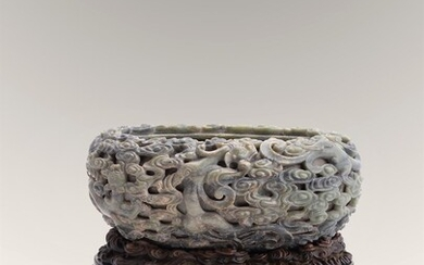 A large Chinese jade 'Dragon' washer