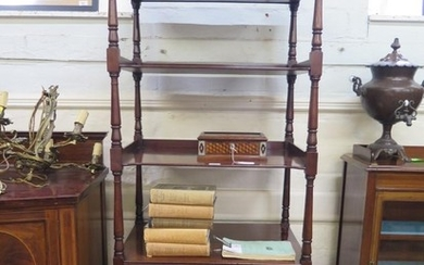 A mid 19th century mahogany whatnot, the four tiers over a p...