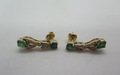 A pair of 18ct yellow gold, tested, emerald and diamond earr...