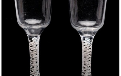 A pair of English opaque twist wine glasses: each with ogee ...