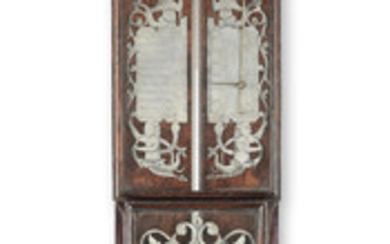 A rare late 18th century Dutch walnut barometer with pewter scales
