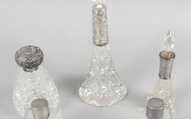 A selection of silver mounted or lidded glass dressing table bottles and jars, plus an assortment of silver mounted button hooks and shoe horns, etc. (25).
