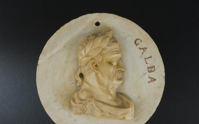 A white marble and giallo di Siena medallion