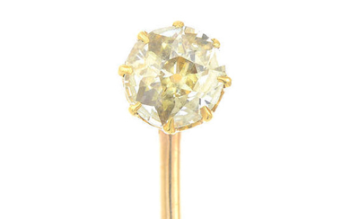 An early 20th century gold old-cut yellow diamond stickpin.