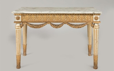 CONSOLE in carved wood, gilded and rechampi, with alternating foliage decoration and oak garlands, resting on tapered, fluted, acanthus-leafed feet. Top in veined Carrara marble. Louis XVI period. 83 x 116 x 55 cm. Accidents and restorations.