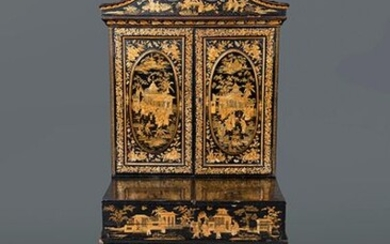 "Cantonese Cabinet, end of 19th century. In black lacquered wood with ""chiniseries"" decoration in gold. Upper part with double door and interior divided into drawers and central doors. Table with compartmentalized interior and different sewing tools"