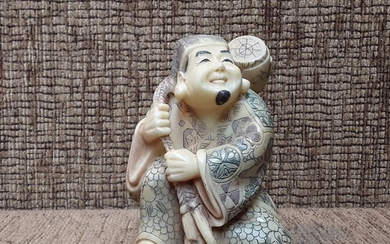 Chinese / Japanese ivory figure of a man carrying a barrel 1...