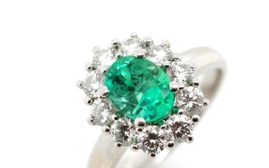 Emerald and diamond set platinum cluster ring, marked PT. Ap...