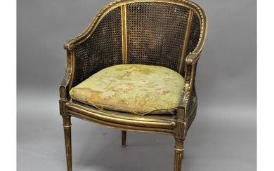 FRENCH LOUIS XVI STYLE GILT BERGERE the double caned back an...