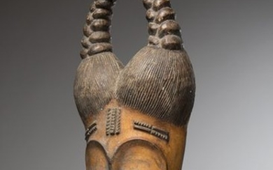 GOURO/BAOULE, Ivory Coast. Family mask with double bun...
