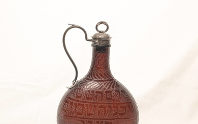 Glass decanter with silver stopper and handle.