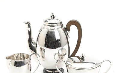 H. S. Mathiesen: A Danish 20th century silver coffee set comprising coffee pot with bakelite handle and footrim and a sugar and cream set. (3)