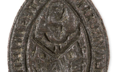 "Medieval Seal Matrix.- Seal matrix inscribed ""Pro Me Lavren Pe Tost Es Id Hom Habti"", legend surrounding an image of St Lawrence holding a Gospel book in his right hand and a grid iron in his left, bronze seal matrix, [14th century]."