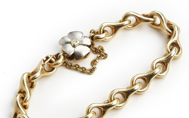"""Ole Lynggaard: A bracelet """"Mega"""" with a diamond clasp """"Flower"""" set with brilliant-cut diamonds, mounted in 14k gold and white gold. Weight app. 63 g."""