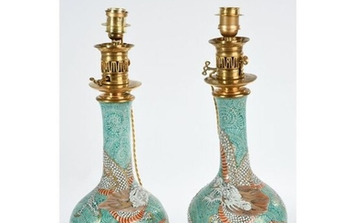 PAIR OF PLEASANT Porcelain VASES mounted as a dragon patterned lamp in the middle of a leafy landscape. Gilded bronze frames with floral and stylized decoration. Ep.XIXth. H.51.