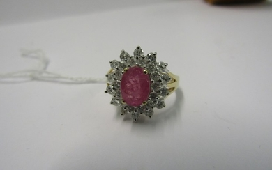 PINK SAPPHIRE & DIAMOND CLUSTER RING, principle oval cut pin...