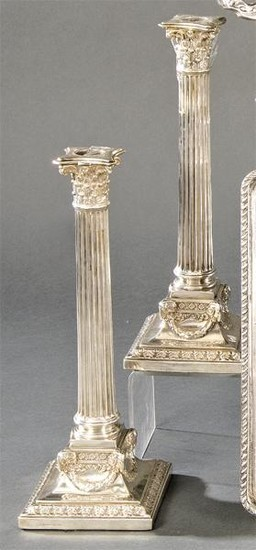 Pair of English silver candlesticks punched Sterling