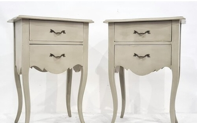 Pair of modern bedside tables with shaped tops and moulded e...