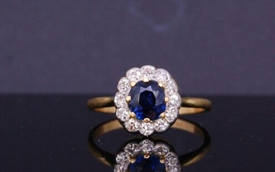 SAPPHIRE AND DIAMOND CLUSTER RING, set with a...