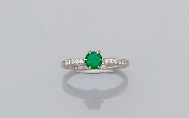 Solitaire ring in white gold, 750 MM, set with a green garnet, round tsavorite weighing 0.62 carat and two lines of brilliants, size: 54, weight: 2.95gr. gross.