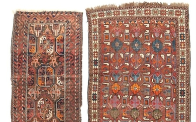 sTwo Nomad rugs, classic design with ornaments on brown and reddish base. 20th century first half. 158×83 and 167×120 cm. (2)