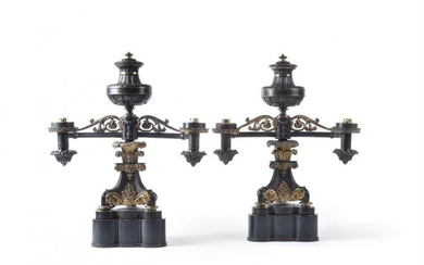 A pair of fine William IV parcel gilt and patinated metal twin light Argand table lamps, circa 1830 and later adapted for electricity