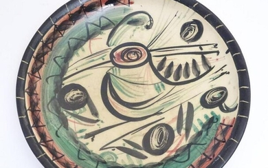 A 20thC studio pottery charger with hand painted