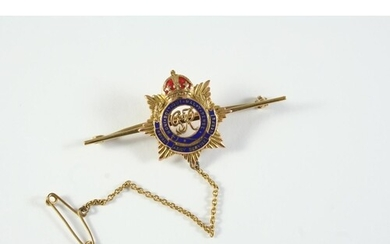 A 9CT GOLD AND ENAMEL REGIMENTAL BROOCH FOR THE ROYAL ARMY ...