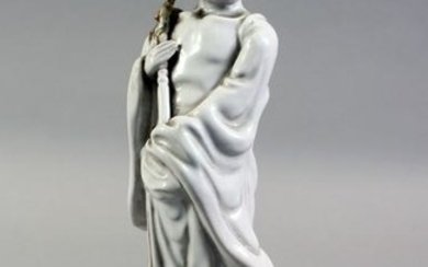 A CHINESE BLANC DE CHINE PORCELAIN FIGURE OF A BOY,
