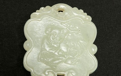 A CHINESE CELADON JADE PENDANT, carved to one side with