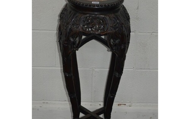 A CHINESE HARDWOOD CIRCULAR JARDINIERE STAND with a veined m...