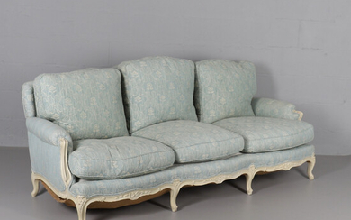 A CREAM PAINTED THREE SEATER SETTEE.