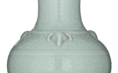 A Chinese celadon relief bottle vase, the handles...