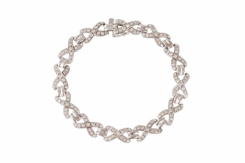 A DIAMOND SET BRACELET, set with diamond x - shaped link, al...