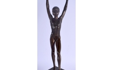 A LARGE 1950S BRONZE FIGURE OF A BALLERINA modelled upon a m...