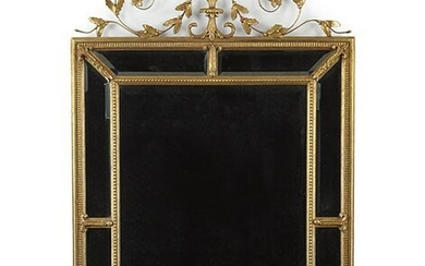 A Neoclassical Style Gesso and Giltwood Mirror.