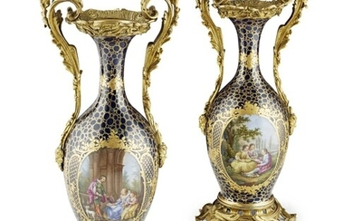 A PAIR OF 19TH CENTURY FRENCH PORCELAIN AND BRONZE ORMOLU VA...