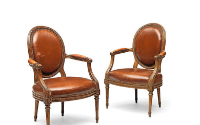 A Pair of Louis XVI carved beechwood fauteuils