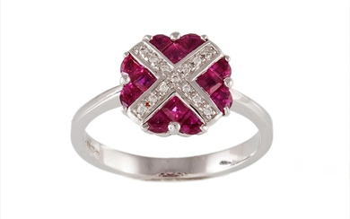 A RUBY AND DIAMOND CLUSTER DRESS RING, with rubies of approx...