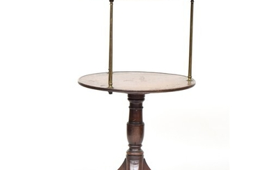 A Regency mahogany two tier dumb waiter, the two moulded tie...