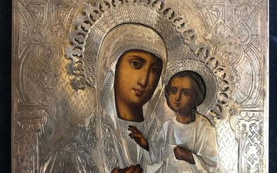 A Russian Icon of The Iverskaya Mother of God with Silver Oklad and Travel Kiot.
