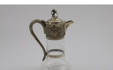 A VICTORIAN MOUNTED CLEAR GLASS CLARET JUG with a baluster b...