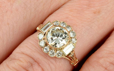 A brilliant-cut diamond cluster ring, with baguette-cut diamond highlights.
