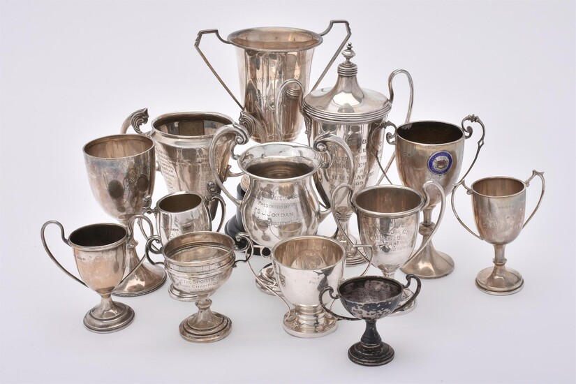 A collection of silver trophy cups