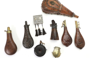A collection of various powder horns and bullit contatiners.